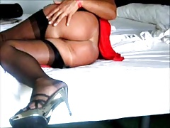 In Bed in Red Skirt my FF nylon stockings and Garter Belt.