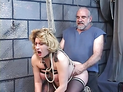 Big tit blonde gets captured by her master.