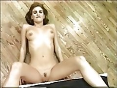 Sexy blond with cute tits does a sensual strip