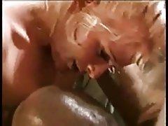 Lovely blonde slut wraps her lips around a hard black cock