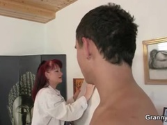 Mature paintress rides his young cock