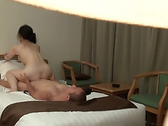 'Mature Japanese Hotel Masseuse with a Perfect Body Has Forbidden Sex with Horny Younger Client'