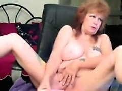 61 yo Brazilian lady is on webcam and showing off her old boobs
