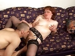 Mature redhead gets her muff munched, fingered and pounded