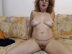 Mature wildly convulses from omibod on cam