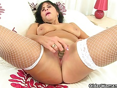British milf Raven loves masturbating in fishnet stockings